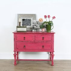 Distressed pink dresser.