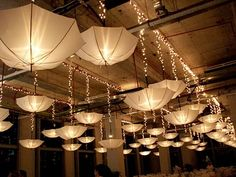 Umbrella decoration ideas So many ways to use umbrellas. Call your friends over or celebrate the rains simply because you love them with these pretty umbrella decoration ideas Wedding Tent Decorations, Umbrella Decorations, White Umbrella, Umbrella Lights, String Lights, Ceiling Lights, Umbrella Wedding, Wedding Umbrellas, Umbrellas Parasols