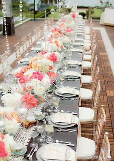 pretty grey tablecloths and colorful flowers