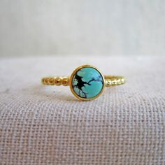 Turquoise bezel ring with a beaded band