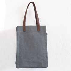 "Ash Waxed Canvas Market Tote Bag 12"" x 16"" x 4"" Printed on recycled canvas with eco-friendly pigment inks. Our canvas totes are soft yet durable, and an easy carry-all. Spot-clean gently as needed. Wi"