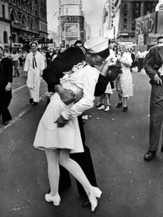American Sailor Clutching a White-Uniformed Nurse in a Passionate Kiss in Times Square by Alfred Eisenstaedt. Photographic print from Art.com.