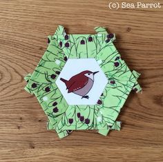Wren and fritillary hexie patchwork block. Original fabrics from Sea Parrot available online from Folksy or directly from me. Patchwork Fabric, Wren, Bird Art, Parrot, Fabrics, Christmas Ornaments, Holiday Decor, Photos, Crafts