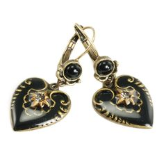 Black enamel hearts are adorned with starbursts set with smoke crystals on these fashion earrings by Sweet Romance. Fancy bezels on leverback clasps complete these burnished bronzetone metal earrings.