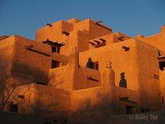 Adobe palace glows at sunset.  #Santa #Fe #New #Mexico.
