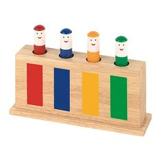 Pop up Toy - A wooden toy with four figures coloured in blue, red, yellow and green that jump up and down on concealed springs. This product will introduce children to colour awareness as well as help build their hand-eye coordination.