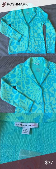 """Isaac Mizrahi Floral Jacquard Sweater Blazer From Isaac Mizrahi Live! With the sophistication of a blazer and the comfort of a sweater. Long sleeves, pointed collar, V-neckline, double button closure, floral print with solid trim. Semi-Fitted. 25"""" L. 19"""" pit to pit flat lay. 100% Cotton. Size S (6-8). New without tags. Never worn. Modeled in a different color. Available in shown Island Blue color. Isaac Mizrahi Sweaters"""