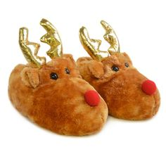 Join Rudolph and the gang this christmas with the Slumberzzz kids novelty Reindeer slippers. These charming slippers will warm your feet as you open up your treats as they are insulated with a foot hugging plush material. The fury outer material features a pair of eye catching golden antlers and the slippers are finished off with Rodolph's signature red nose. Our novelty 3D Reindeer slippers have a low plush fleece pile outer shell and a faux fur inner lining.