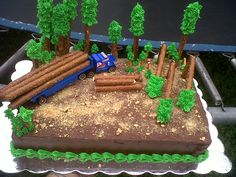 log hauling truck driving cake with pretzel trees