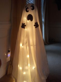 Halloween Ghost. Made with Tomato Cage and Christmas lights.