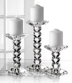 Clear crystal glass and a unique design sets off this terrific trio. A must for any sophisticated home, these candleholders are just perfect for setting on the mantel to bring warmth and elegance to the room.