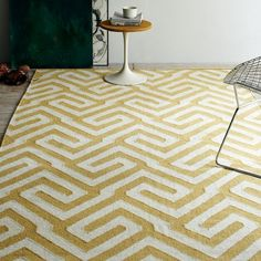 Handwoven by Craftmark-certified artisans in India, the Key Wool Dhurrie features a classic geometric pattern of precise turns and angles. The timeless design adds visual texture to any living space.