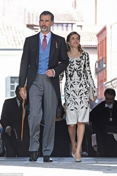 As they arrived at theUniversity of Alcala de Henares where the ceremony was held Letizia could be seen linking arms with her husband in an affectionate gesture