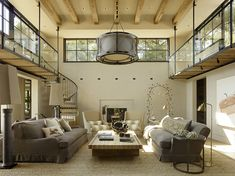 Seaweed   Custom Light Fixture   Rustic Lighting   Luxury Lights   Wine Country   Custom Chandelier   #BlankandCables Highlighting this Sonoma County estate's natural textures and colors, this wood and steel spiral staircase with floating catwalk adds an open and airy lofted touch to this beautiful rustic space. Reclaimed wood accents throughout the home, a pivoting garage window to open the dining room to the outdoors, and custom light fixtures complete this home's modern country feel.