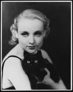 Carole Lombard poses with her cat in the 1930s.