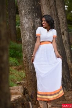 Want to buy the latest fashion in Ethiopian women dresses online? A huge collection of unique and traditional Ethiopian dresses in one click away. African Dresses For Women, African Attire, African Wear, African Fashion Dresses, African Women, Ethiopian Traditional Dress, African Traditional Dresses, Traditional Outfits, Ethiopian Hair