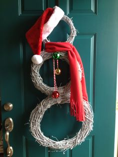 My snowman door wreath made from 3 grapevine wreaths.