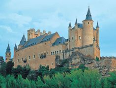 Alcázar of Segovia, Segovia, Spain. This castle originally started out as a fort and has served as the royal palace at times in its history. It is designed to look like the bow of a ship emerging from the mountains.