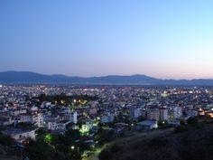 Modern Greek city at dusk.