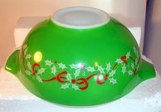 Vintage Pyrex promotional holiday bowl with holly on one side and Merry Christmas and Happy New Year on the other side. (I love Christmas and Pyrex Cinderella bowls, so I'm excited to know these ever existed!)