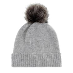 A baby-soft pale grey cashmere beanie topped with a luxurious fluffy Lady grey faux fur pom-pom.  This adorable beanie is 100% cashmere and made in Scotland. One size.