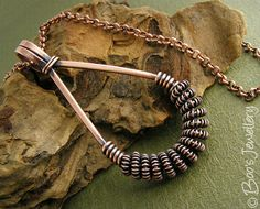 Antiqued copper necklace: featuring a teardrop shaped pendant wire wrapped with spiralled coils