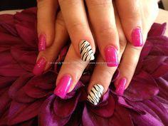 Full set of acrylic nails with zebra print nail art on ring finger