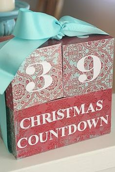 Mod Podge scrapbook paper over wooden blocks to create a holiday countdown. I need to make asap!