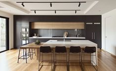 High Street by Alta Architecture (6) love the combo of wood, dark cabinets and white counter tops.