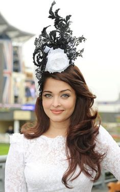 Aishwarya Rai Decorative Hat Aishwarya Rai had us looking to the clouds with this sky-high rosebud and lace topper.