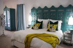 Teal ROOMS | Teal green accents this eclectic bedroom with an ornate painted ...