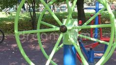 Video about Fitness equipment in the park - wheel view outdoor sports equipment of sports in the park. Video of view, park, clip - 61156271