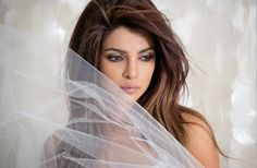 """We're loving Priyanka Chopra's casual style and subtle smokey eye in her new music video, """"I can't make you love me."""""""