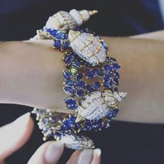 """Beauty, to me, whether found in nature or in man-made objects, is ennobling and enriches the soul."" - David Rockefeller Christie's is very proud to offer...This sapphire, diamond and emerald 'Sea Shells' bracelet was designed by Jean Schlumberger, Tiffany & Co."