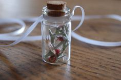 Necklace with a small glass jar with dried herbs and flowers from the garden by simplyAgift on Etsy