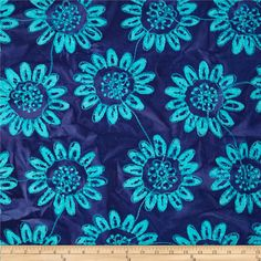 Textile Creations Embroidered Rayon Batik Sunflower Turquoise/Purple from @fabricdotcom  This embroidered rayon batik fabric has a beautiful full bodied drape. It features an embroidered design throughout the fabric. Perfect for creating stylish shirts, blouses, drapey jackets, gathered skirts or fuller dresses with a lining. Colors include shades of deep blue with turquoise. Embroidered stitching is pearlized turquoise.