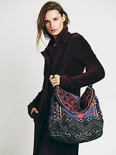 Indian Summer Hobo | Colorfully woven and embroidered hobo bag with studded leather handle. Folder zipper closure at the top. Zipper compartment on the front. Inside is fully lined with two pouches.   *By Free People   $128