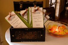 Olive green double sheet programs with an orange bow | villasiena.cc