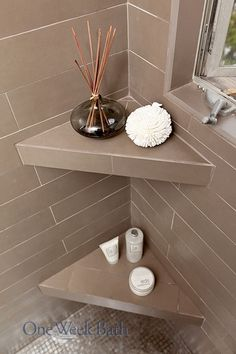 STORAGE TIP: Corner shelving in your shower can be useful for placing shampoos, soaps, scrubs, and even diffusers. When installed at the right height, built-in shower shelving can provide an accessible shelf space for anyone. Features like this are functional, design-forward and universal. (Contact us to see how we can upgrade your bathroom design with shower shelving like this: http://www.oneweekbath.com/pin-it/)