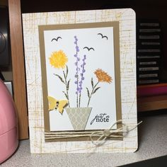 Flower pot card.  Used Stampin Up! triangle punch for the pot and bitty butterfly punch.
