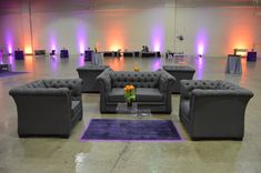 Gray tufted seating with acrylic nesting tables. We LOVE this seating!