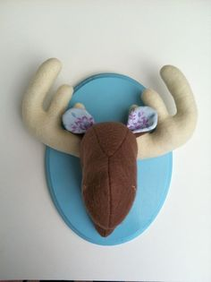 Should hang this in the little mans room.  Moose felt taxidermy.  So funny!