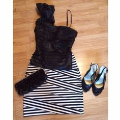 Black Ruffle Strap Tank black shimmery tank with one ruffle strap • almost bandage look but doesn't fit too tight • marked size large/can fit medium • back gathered stretch material • thin strap pictured not included • purchased at small local boutique Tops Tank Tops