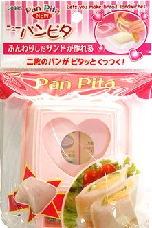 This is a Cute Japanese Bento Accessories Sandwich Maker PAN PITA. It is easy to make yummy sandwiches for your bento box lunch!    1 - You put your favorite food between 2 sliced breads. 2 - Put 2 sliced breads together and press them by this sandwich maker like the picture shows 3 - Take out the edge of sliced breads and it is done!!    You can arrange food inside of breads as you like.