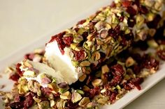 Thanksgiving appetizer. Goat cheese log with cranberries and pistachios