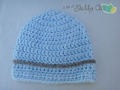 Simple but adorable crochet beanie for a baby boy. Baby blue with a gray/brown stripe. Comes with a matching pair of booties! #booties #beanie #hat #babyboy #baby #babyshower #babyblue #gift #DIY #crochet #knit #abitofshabbychic