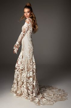 Avril from Rue de Seine wedding dresses 2016 - High neckline with long sleeves in a cornelli lace throughout, cut out designs in the train and sleeves. Full skirt with train- see the rest of the collection on www.onefabday.com