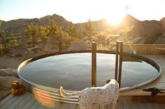 This is a stock tank pool at a desert mountain house. I saw it on poppytalk. I'm thinking that's a great idea but it has to be deep so it's like a swimming hole minus the sharp rocks.