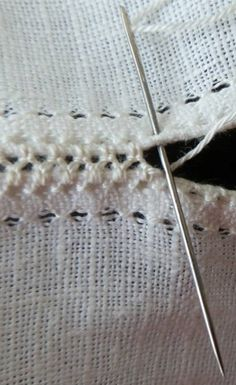 Ukraine, from Iryna ~ fancy twisted interlocking stitchwork to join two pieces of fabric. Picture is big enough that I can see where the needle goes and how the thread wraps around in this embroidery technique. Try this to put together knitted or crocheted pieces?