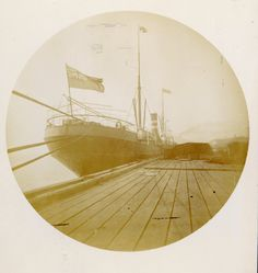British Freighter at Port of New Orleans, ca. 1893. This photograph portrays an English steam ship at Port of New Orleans in New Orleans, Louisiana, ca. 1893. Ship is flying the British Naval Ensign at stern. Pier is on starboard side of ship. Cargo (covered) is seen on the pier, and a building is seen in the background. http://hdl.handle.net/1920/18 George Mason University Special Collections and Archives